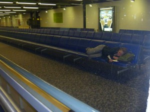 Christy sleeping in Gatwick gate 11