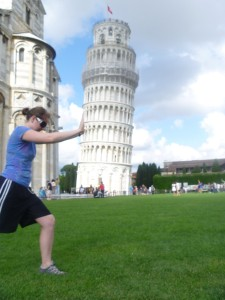 Christy pushing over the leaning tower of Pisa
