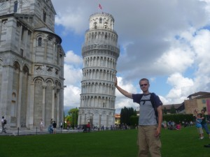 Aaron holding up the leaning tower of Pisa after Christy pushed it over