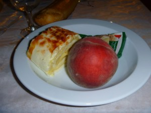 A pastery, peach, and roquefort cheese