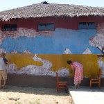 Aaron helping with a mural at a Tanzanian school