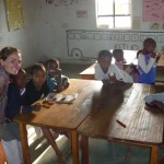 Christy helping with craft time in a Tanzanian school