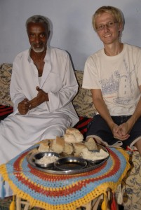 Aaron and Ali eating lunch in a Nubian village