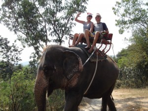 Christy and Aaron riding an elephant