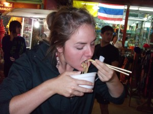 Christy eating a bowl of noodles
